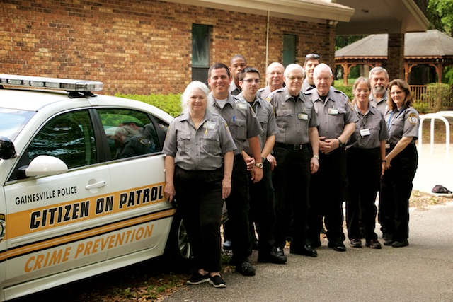 The GPD C.O.P Team standing beside a C.O.P Impala
