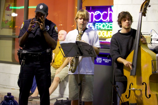 The GPD Downtown Unit, an Officer playing music at the Bo Diddley Plaza