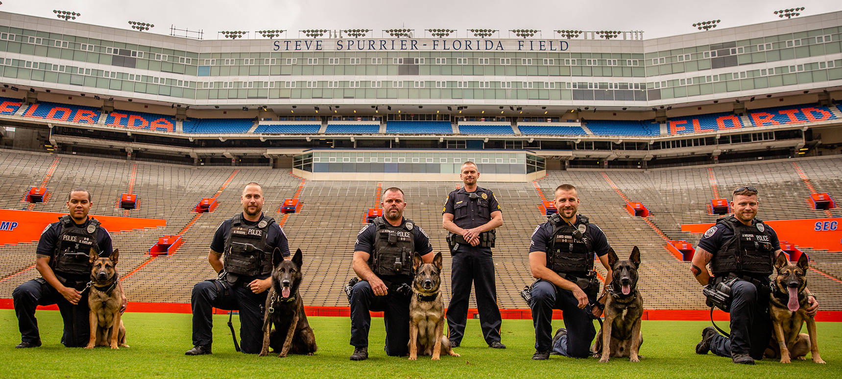 The K9 Officers and their K9 Partners on the field at Ben Hill Griffin Stadium