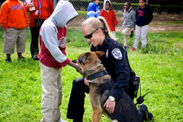 The GPD K9 Unit, an officer and her K9 with a young boy having a friendly conversation